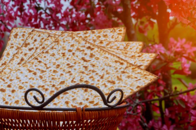 Jewish holiday passover matzot with seder on plate on table close up stock image