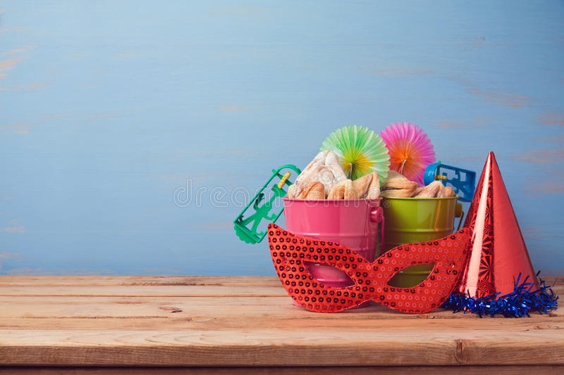 Jewish holiday purim background with carnival mask, hat and buckets stock images