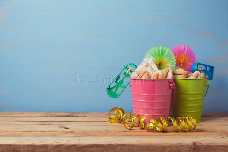 Jewish holiday Purim carnival background with traditional gifts on wooden table royalty free stock photo