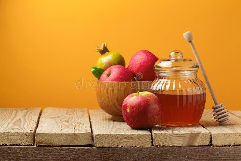 Jewish holiday Rosh Hashana (New Year) celebration with honey jar and apples stock photos