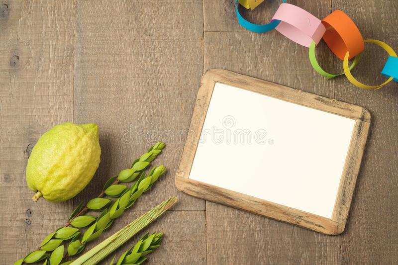 Jewish holiday Sukkot celebration background with picture frame stock photography