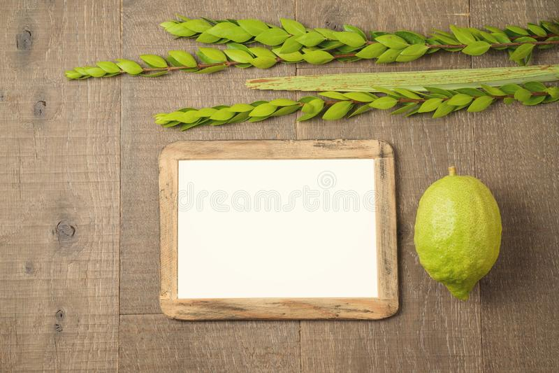Jewish holiday Sukkot celebration background with picture frame royalty free stock photography