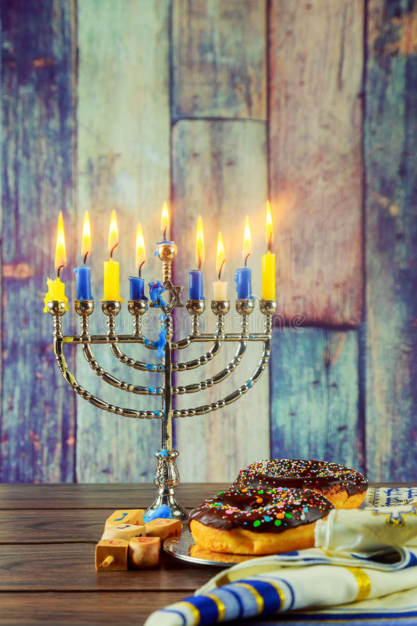 Jewish Holiday symbol Hanukkah background with menorah. Jewish Holiday jewish symbol Hanukkah background with menorah wood dreidel tradition royalty free stock photos