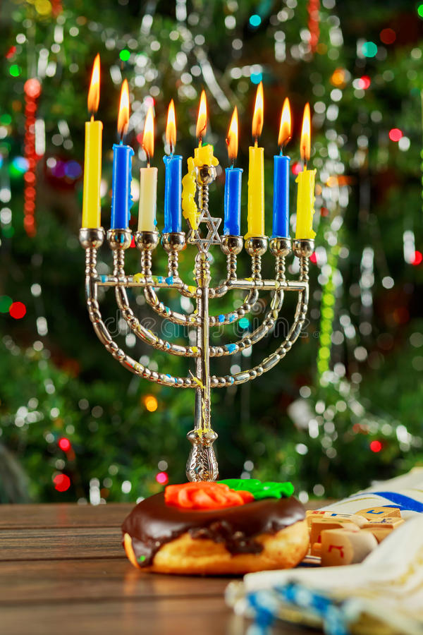 Jewish Holiday symbol Hanukkah background with menorah. Jewish Holiday jewish symbol Hanukkah background with menorah wood dreidel tradition royalty free stock photo
