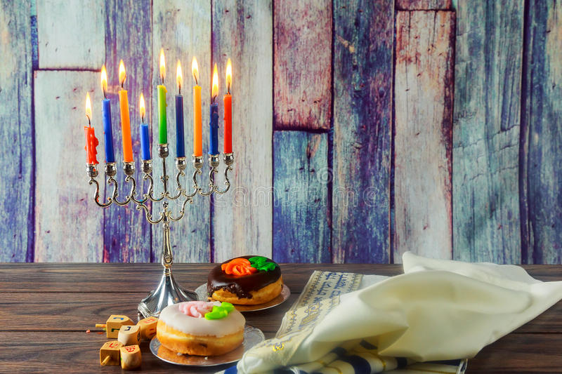 Jewish Holiday symbol Hanukkah background with menorah. Jewish Holiday jewish symbol Hanukkah background with menorah wood dreidel tradition royalty free stock images