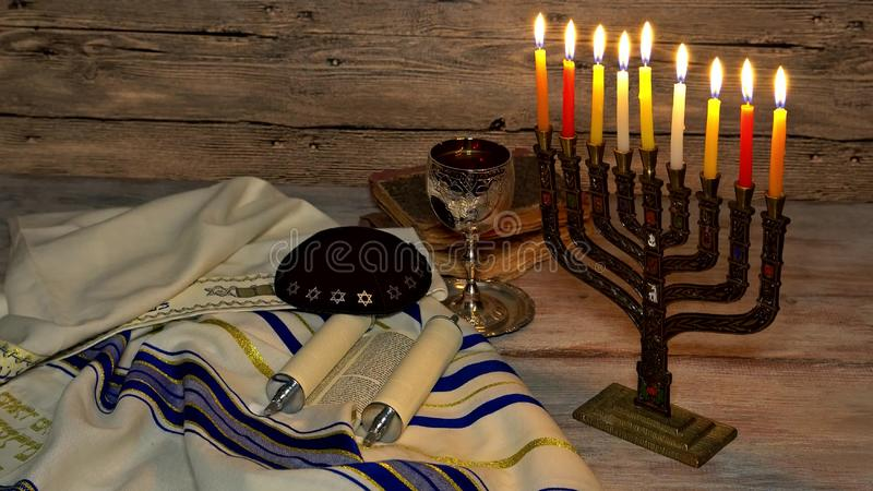 Jewish holiday symbol Hanukkah, the Jewish Festival of Lights. Jewish holiday symbol Hanukkah menorah with burning candles, the Jewish Festival of Lights royalty free stock photos