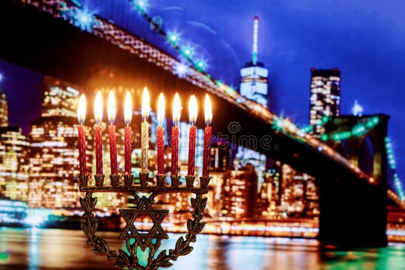 Jewish holiday hannukah symbols menorah, wide view Brooklyn Bridge New York stock photo
