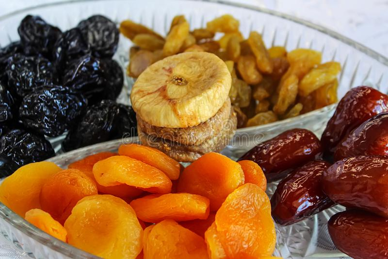 Jewish holiday Tu Bishvat, Israel. Traditional dried fruits in a glass tray. Apricots, Dates, Raisins, Prunes, Figs stock photography