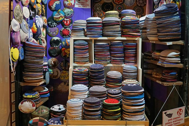 Jewish kippa shop in Jerusalem. JERUSALEM - JANUARY 2019: The Ben Yehudah Street pedestrian mall has numerous specialty shops, such as this one devoted to the stock images