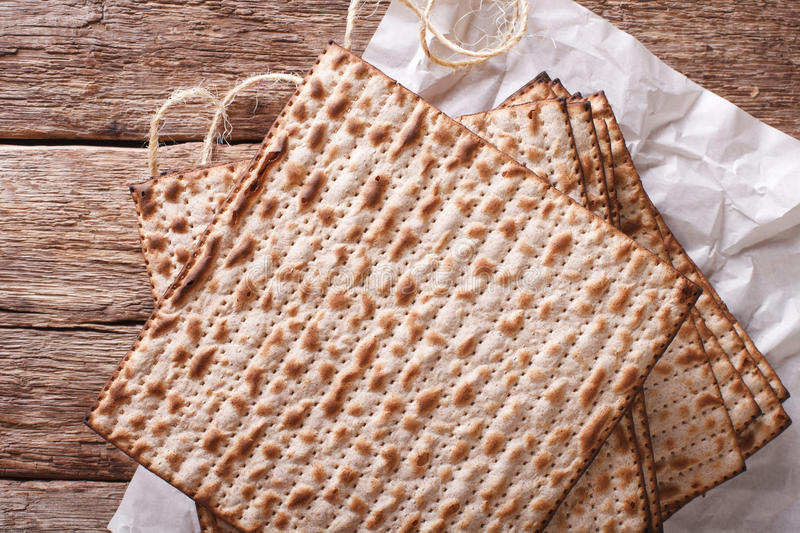 Jewish kosher matzo for Passover closeup on a wooden table. horizontal top view royalty free stock photography