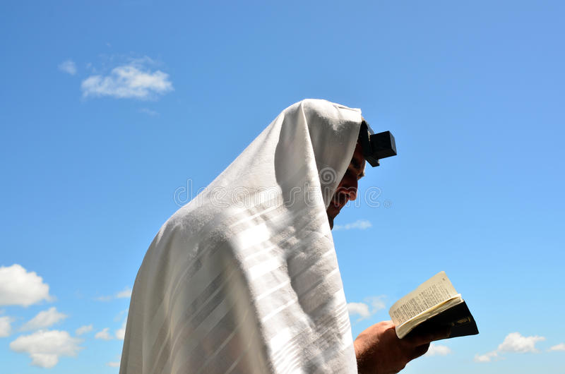 Jewish man pray to God under the open blue sky royalty free stock photography