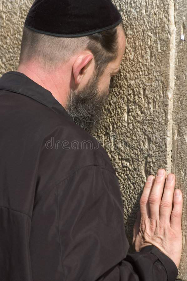A jewish man is praying in Jerusalem royalty free stock images