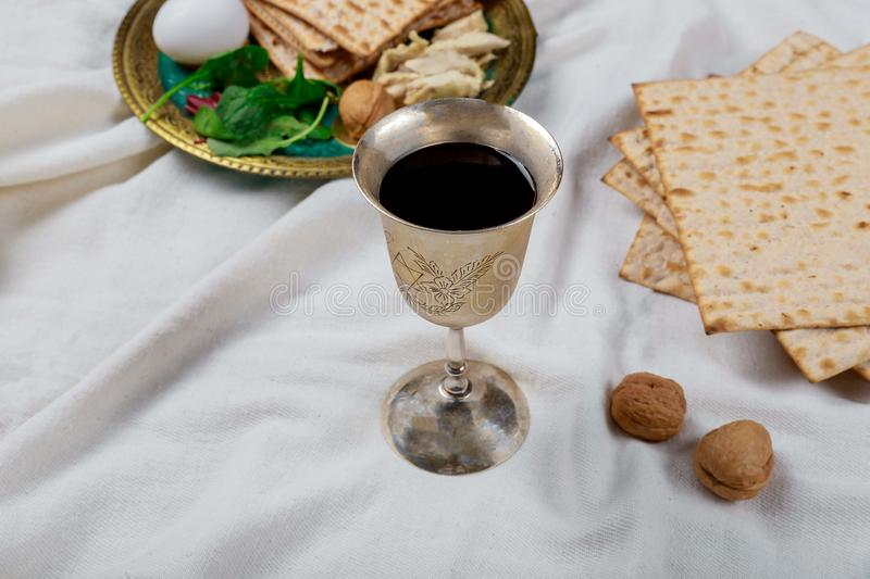 A Jewish Matzah bread with wine. Passover holiday concept. Jewish passover holiday pesah celebration matzah bread with kosher wine judaism unleavened seder royalty free stock photos