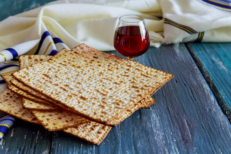 A Jewish Matzah bread with wine. Passover holiday concept. Jewish passover holiday pesah celebration matzah bread with kosher wine judaism unleavened seder royalty free stock images