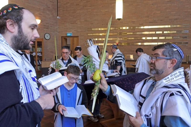 Jewish men praying in synagogue on the Jewish holiday festival o stock image
