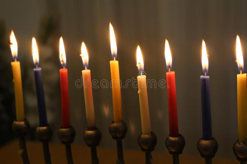Jewish menorah with candles for Hanukkah Judaic holiday symbol. Jewish menorah with colorful candles for Hanukkah Judaic holiday symbol stock photo