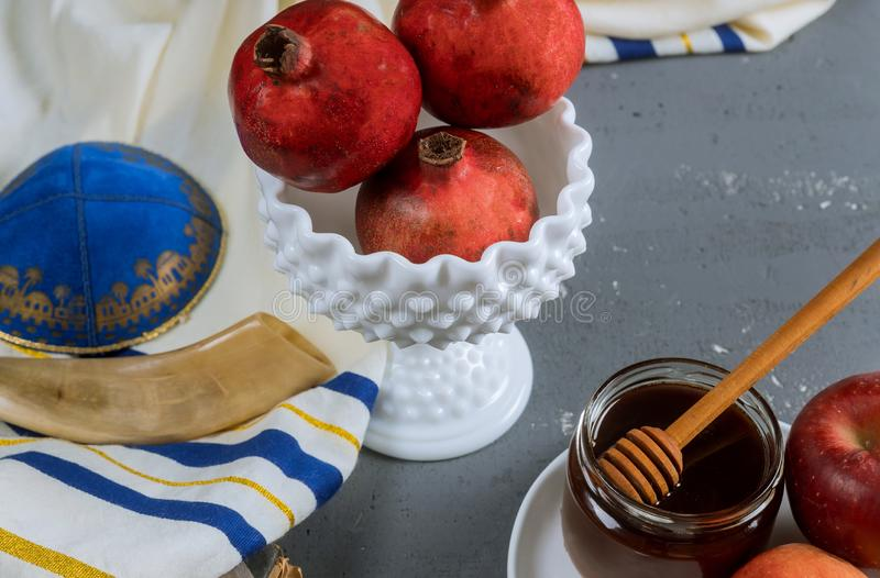 A jewish new year with honey for the apple and pomegranate holiday of Rosh Ha Shana. Jewish prays, holidays, hashana, yom, kippur, horn, judaism, prayer, kosher stock images