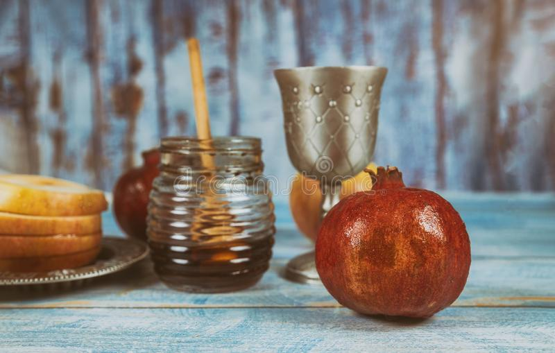 Jewish new year symbol with glass honey jar and fresh ripe apples. Rosh hashanah. Jewish new year symbol Rosh hashanah with glass honey jar and fresh ripe apples royalty free stock photos