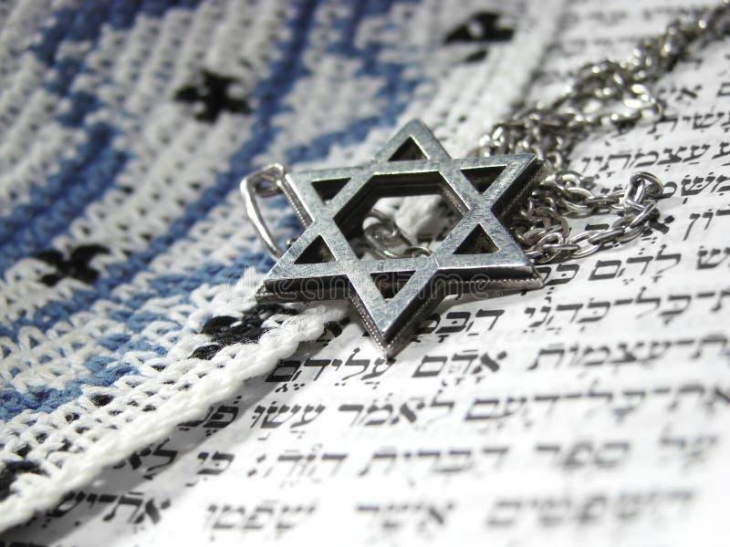Jewish religious symbols closeup 3. Jewish religious symbols - star of David, Torah hebrew, yarmulke - closeup royalty free stock photo