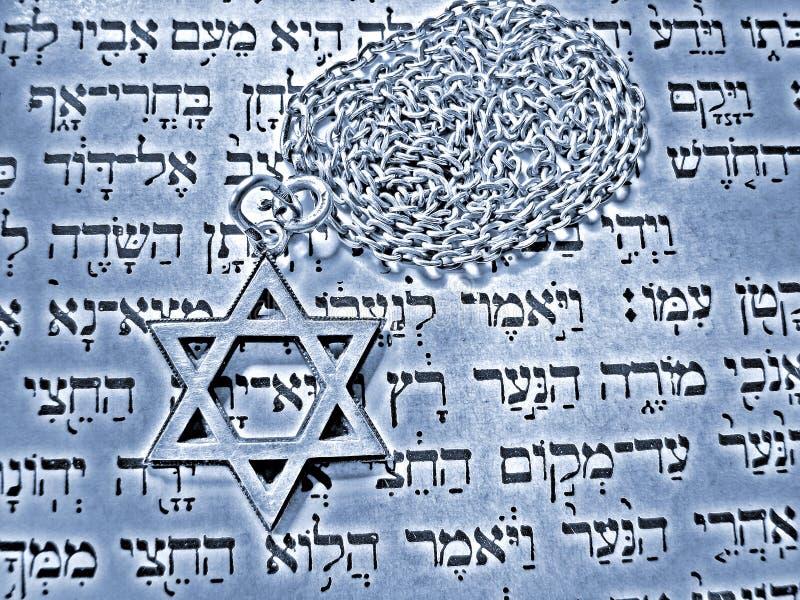 Jewish religious symbols effect. Jewish religious symbols - star of David, Torah hebrew, yarmulke - closeup stock image