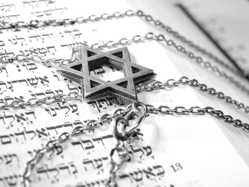 Jewish religious symbols macro 2. Jewish religious symbols - star of David, Torah hebrew, yarmulke - closeup stock photos