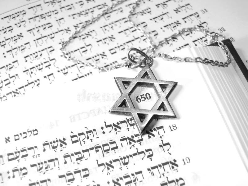 Jewish religious symbols macro 3. Jewish religious symbols - star of David, Torah hebrew, yarmulke - closeup stock photography