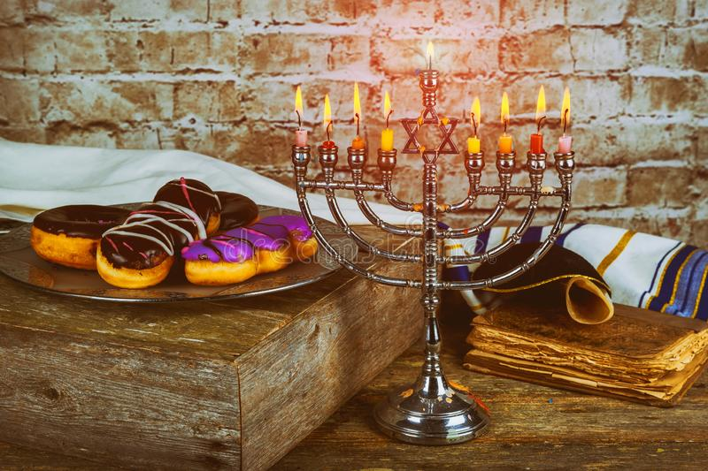 Jewish holiday Hanukkah with menorah traditional burning candles stock photos