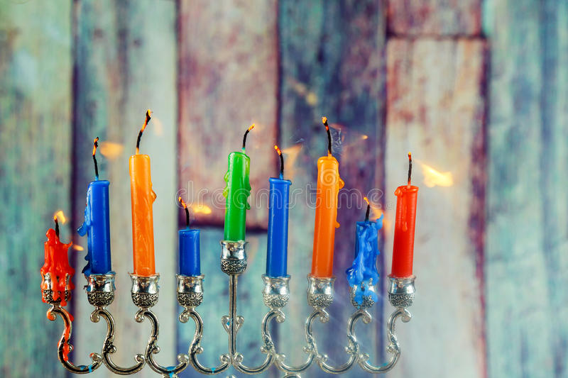 Jewish symbol Hanukkah with menorah traditional. Jewish symbol jewish holiday Hanukkah with menorah traditional Candelabra and wooden dreidels spinning top royalty free stock images