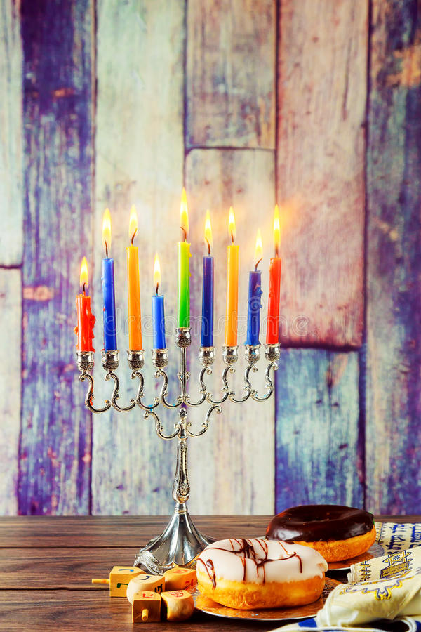 Jewish symbol Hanukkah with menorah traditional. Jewish symbol jewish holiday Hanukkah with menorah traditional Candelabra and wooden dreidels spinning top stock images