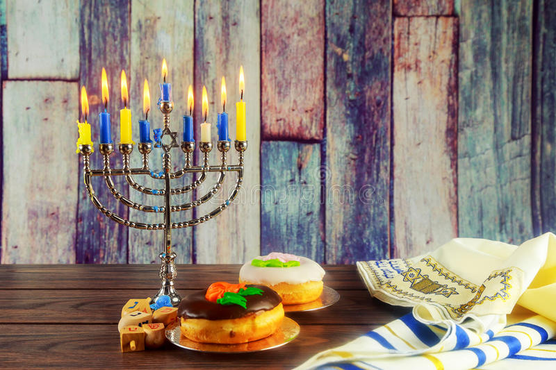 Jewish symbol Hanukkah with menorah traditional. Jewish symbol jewish holiday Hanukkah with menorah traditional Candelabra and wooden dreidels spinning top royalty free stock photo