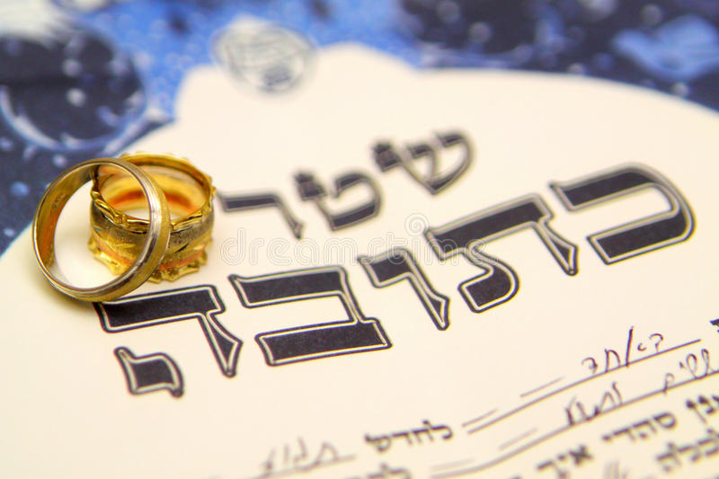 Jewish wedding. Ketubah with 2 rings stock photography