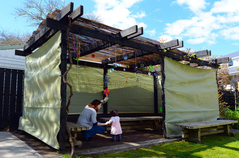 Jewish woman and child visiting their family Sukkah stock photos