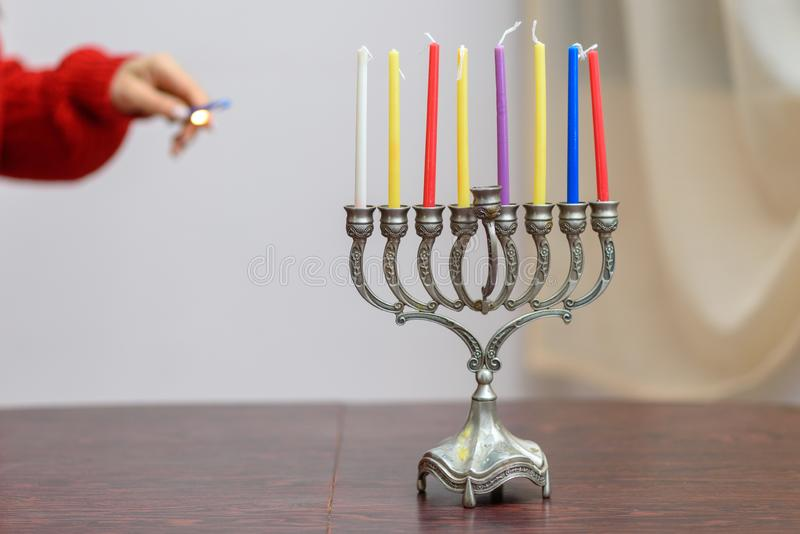 Jewish holiday Hanukkah background with menorah and colorful candles. royalty free stock photos