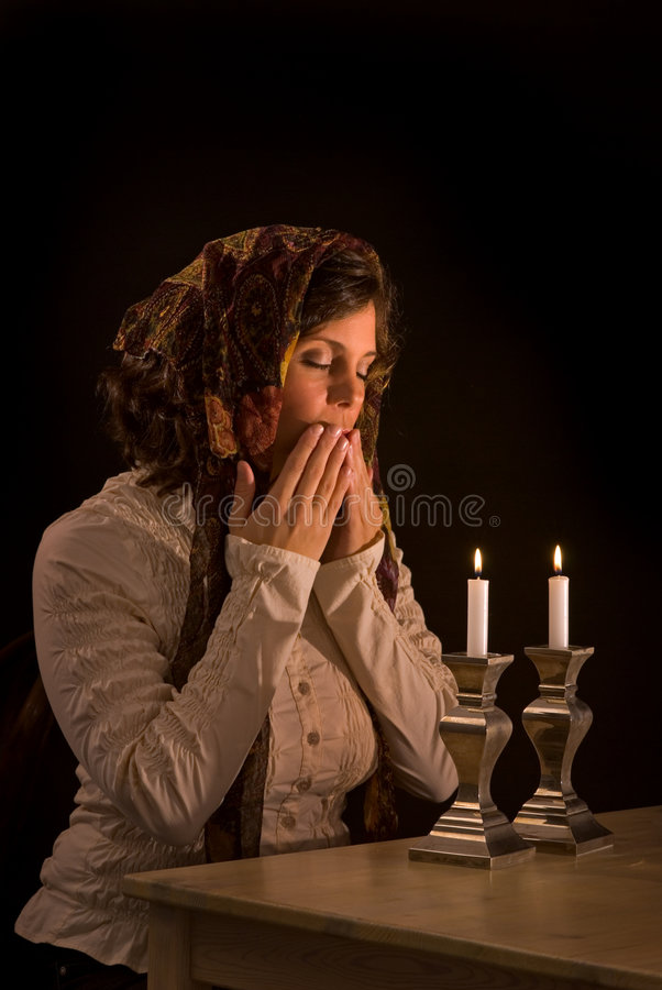 Download Jewish Woman Prays Over Sabbath Candles Stock Image - Image: 6476383
