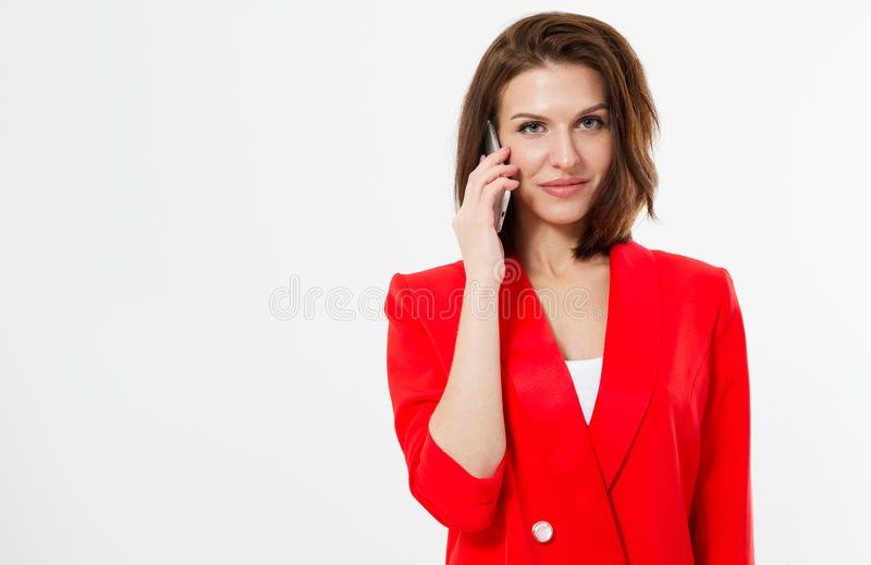Jewish woman in red business suit talking on phone isolated on white backgrouns.  royalty free stock photography