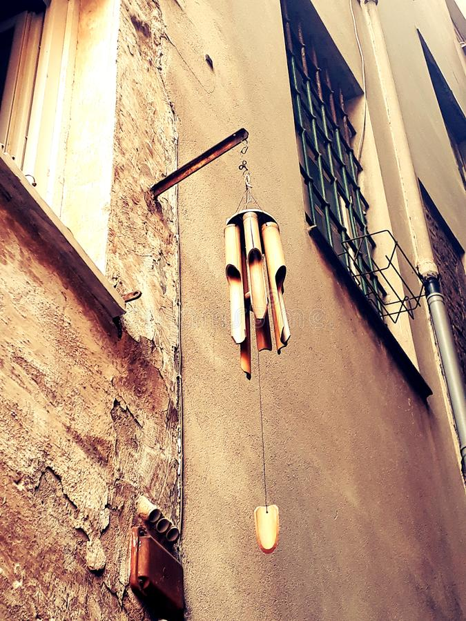 Jews arp in an alley. Genoa, Italy, center. A jews arp, home decoration, it sounds with the wind stock image