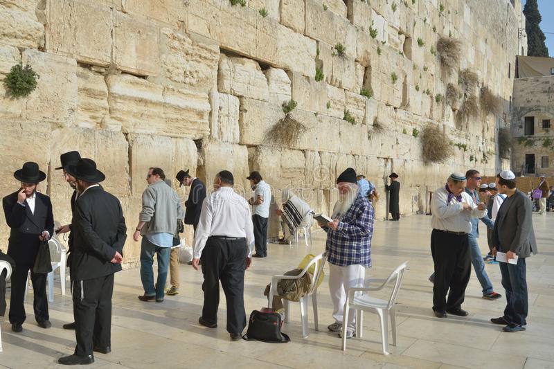 Jews under the Western Wall in Jerusalem, Israel. Jerusalem, Israel - March 20, 2014: Jews pray under the Western Wall in the Old city. The Old City is listed as stock image