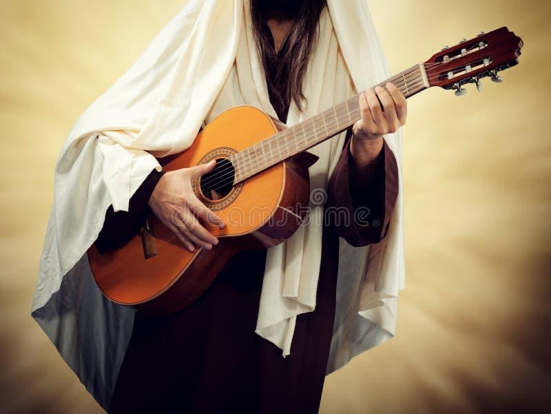 Jezus Chrystus bawić się gitarę zdjęcie stock