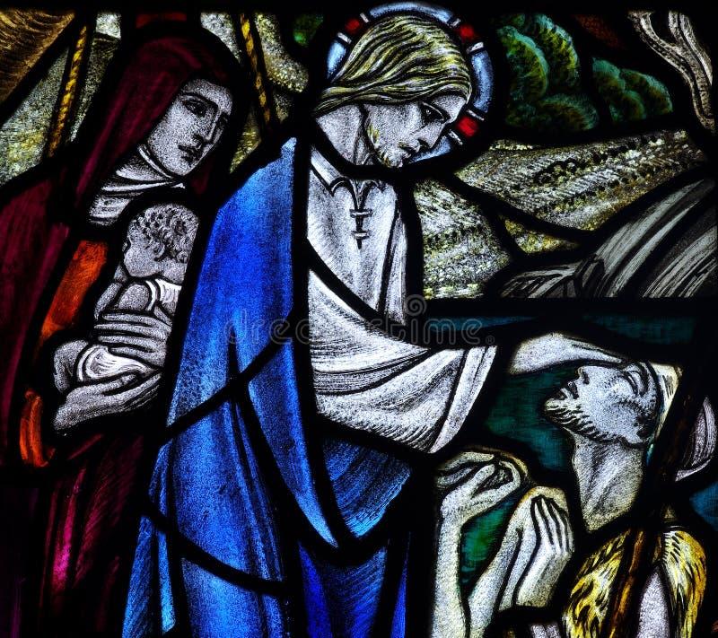Jezus Chrystus leczy niewidomej osoby w witrażu obrazy royalty free