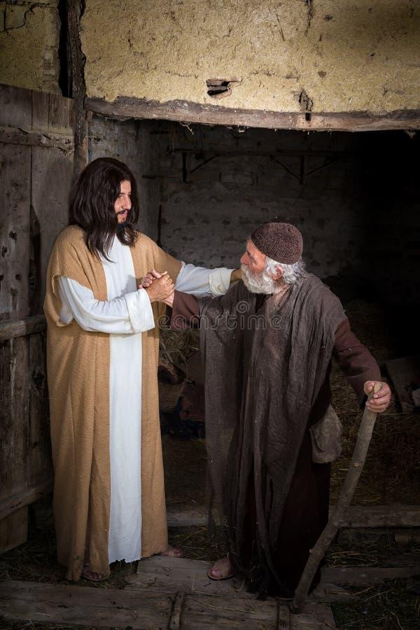 Jezus leczy kalekiego mężczyzna zdjęcie stock