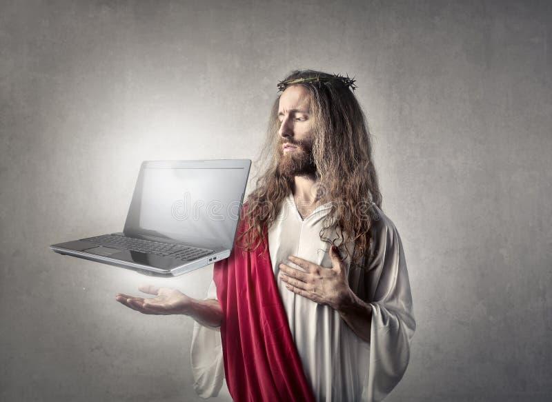 Jezus z laptopem fotografia stock