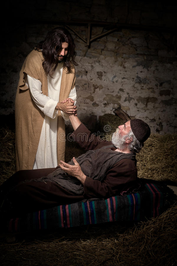 Jezusowy gojenie kaleki mężczyzna obraz stock