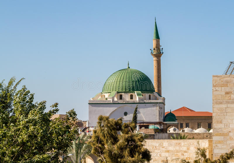 The Jezzar Pasha Mosque in Akko, Israel. The Jezzar Pasha Mosque, also known as the White Mosque, in Old City of Akko, or Acre, Israel stock photo