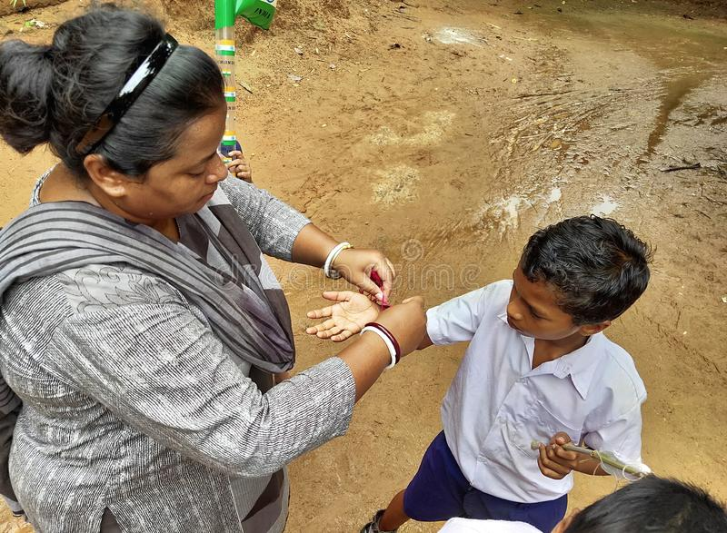 Rakshabandhan, celebrated in a rural Primary School in India. Jhargram, India- August 15, 2019: Rakshabandhan, celebrated in a rural Primary School in India as a stock photos