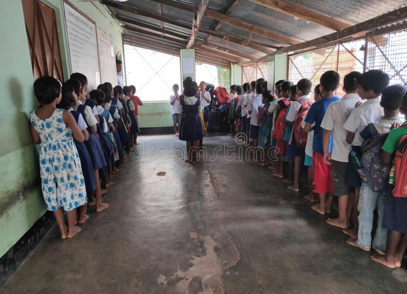 school students stand in line for prayer in a primary school in West Bengal, India stock photography