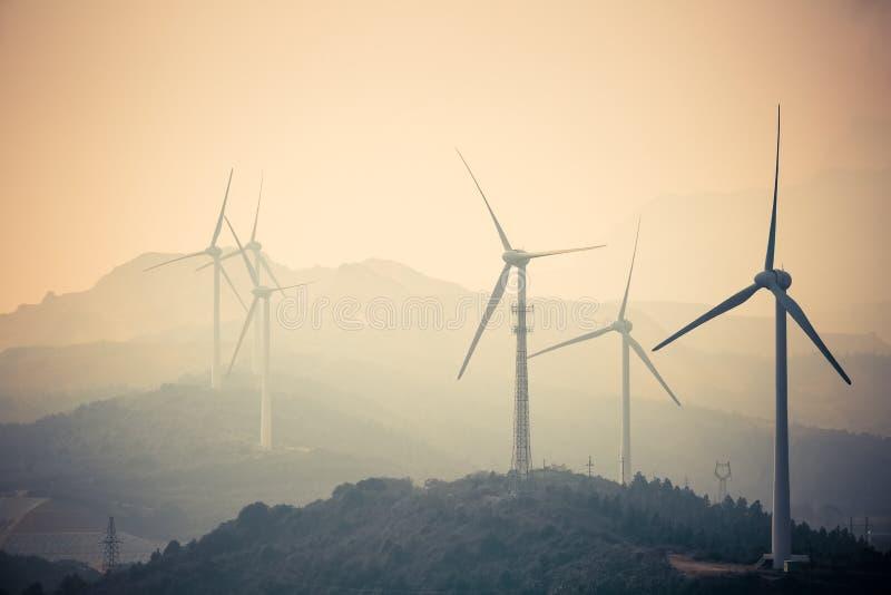 Jiangxi new energy. Wind farm at dusk - new energy in jiangxi lushan mountain ,poyang lakeside royalty free stock photo