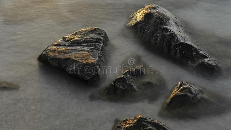 Reefs and waves. Jiaodong Peninsula is located in the northeast coastal area of China`s North China Plain, east of Shandong Province, hilly land, north of Bohai royalty free stock image