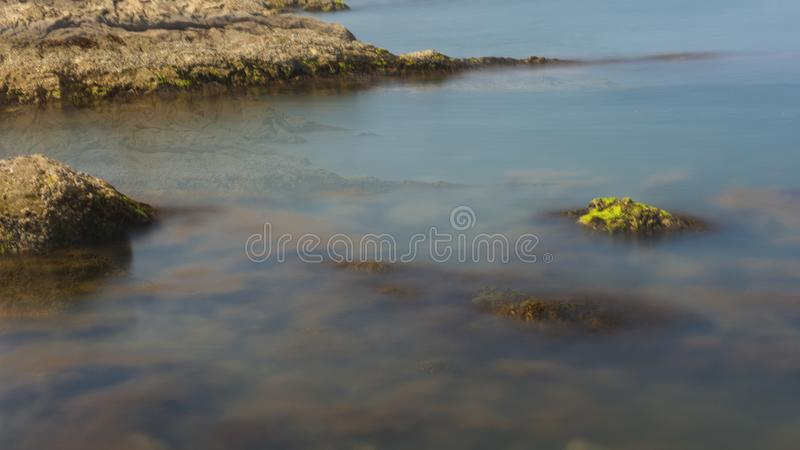 Reefs and waves. Jiaodong Peninsula is located in the northeast coastal area of China`s North China Plain, east of Shandong Province, hilly land, north of Bohai stock image