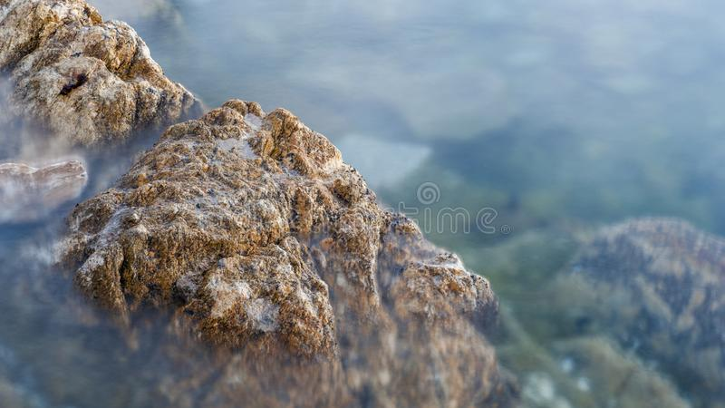 Reefs and waves. Jiaodong Peninsula is located in the northeast coastal area of China`s North China Plain, east of Shandong Province, hilly land, north of Bohai royalty free stock photo