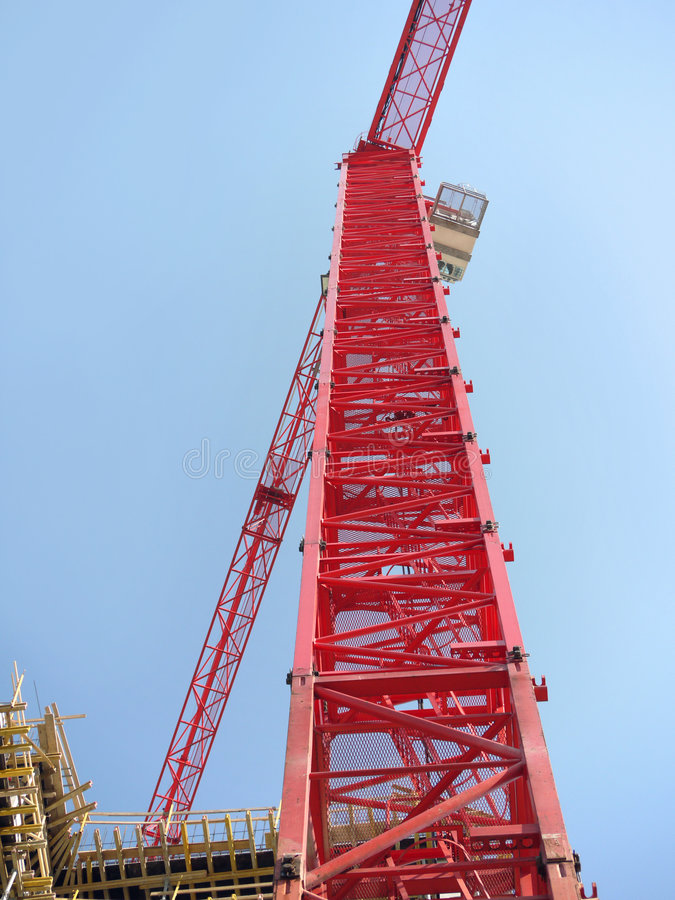 Jib crane. Closeup of red jib crane over blue sky royalty free stock photography